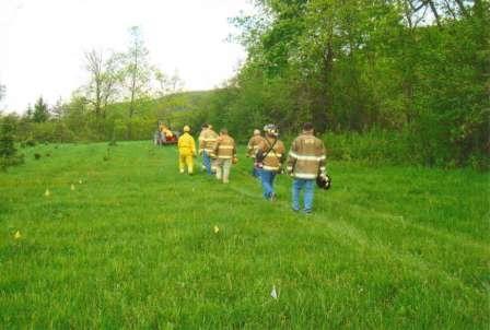 firefighters in a field