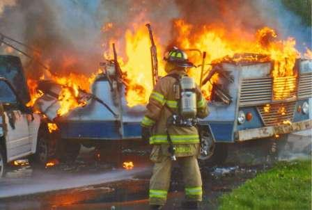 firefighters and burning vehicles