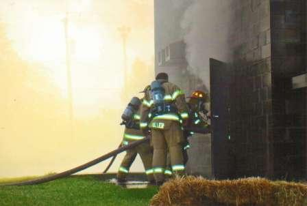 firefighters and a burning building