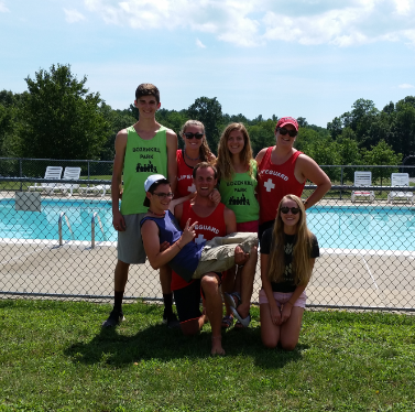 group of kids outside at a pool