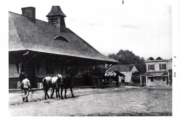 black and white photo of a train station building