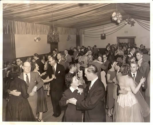 black and white photo of people at a dance
